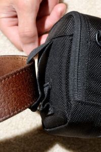 Pulling the belt through the strap loop