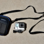 very small GoPro case with original shoulder strap